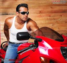 Salman Khan sitting on a red