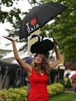 Racegoer Jenny Munklik wears a black swan style hat